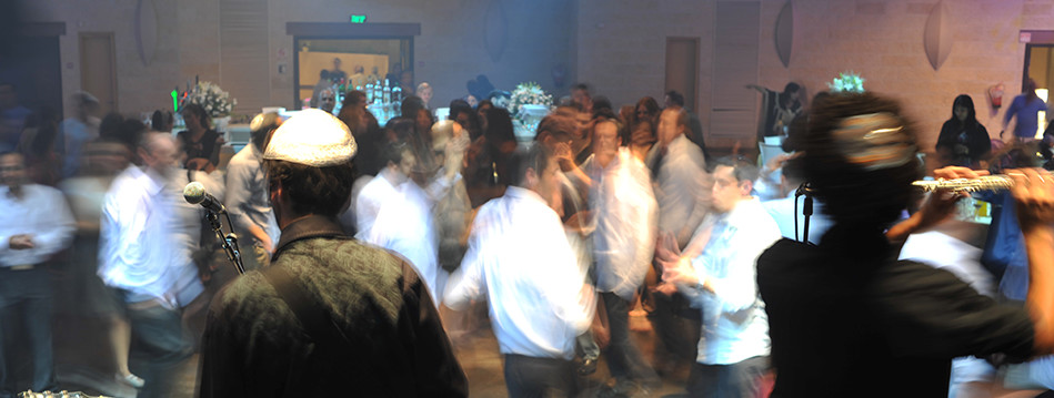 Image 3 from slider in 'About Us' page - people dancing at wedding