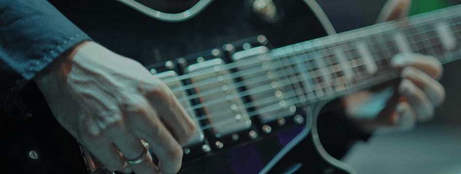 Image 2 from slider in 'About Us' page - electric guitar
